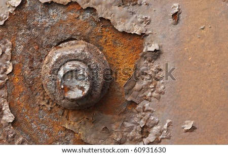 Rusty nut at the surface of steel plate closeup - stock photo