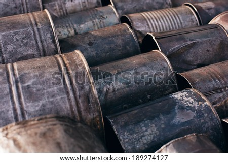 rusty old cans at sunny day - stock photo