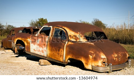 Rusty Old Car on Blocks - stock photo