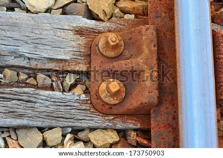 Rusty old railway track detail - stock photo