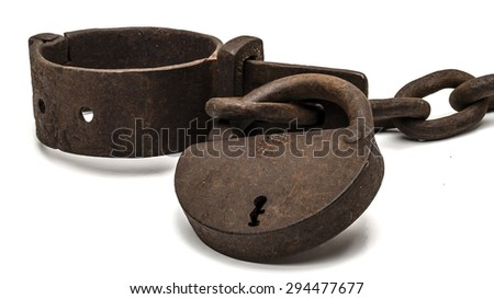 Rusty old shackles with padlock used for locking up prisoners or slaves between 1600 and 1800.  - stock photo