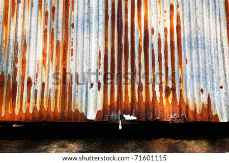 Rusty on zinc metal plate texture - stock photo