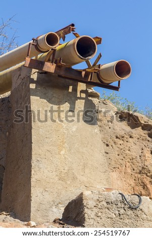 rusty pipes and an old abandoned factory - stock photo