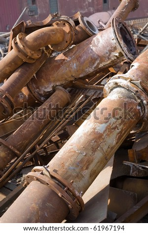 Rusty pipes of old factory - stock photo