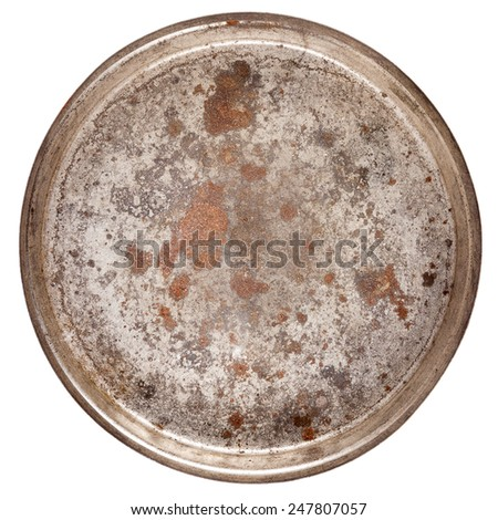 Rusty round metal plate isolated on white - stock photo