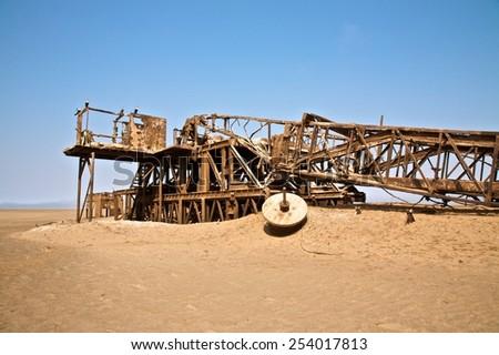 rusty ruins in the desert - stock photo