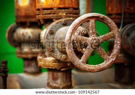 Rusty sewer valve - underground old sewage treatment plant in Shanghai. - stock photo