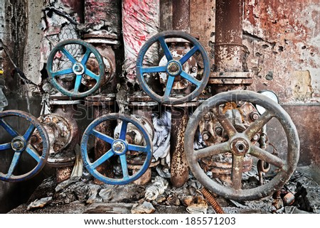 Rusty sewer valve - underground old sewage treatment plant in Shanghai - stock photo