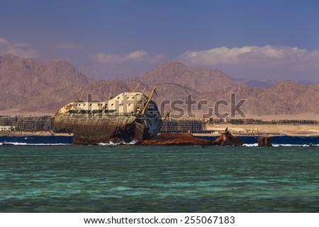 Rusty ship off the coast of Egypt. - stock photo