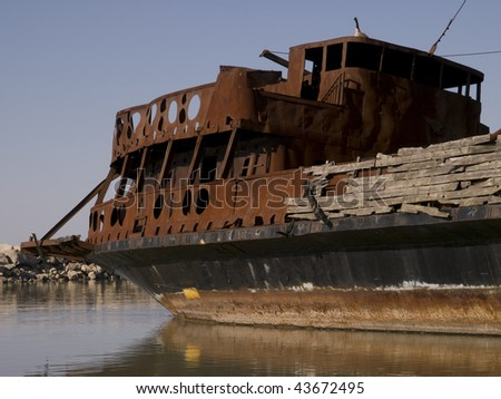 Rusty shipwreck on lake Ontario on a clear blue sky day. Lake Ontario, Ontario, Canada. - stock photo
