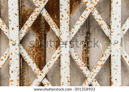 Rusty sliding metal door in suburb of Thailand - stock photo