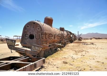 Rusty steam locomotives, train cemetery in Bolivia - stock photo