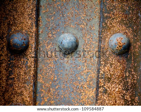 Rusty steel background texture on a plate steel railroad bridge - stock photo