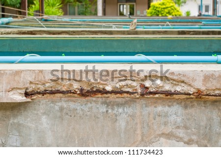 Rusty steel bars and broken concrete - stock photo