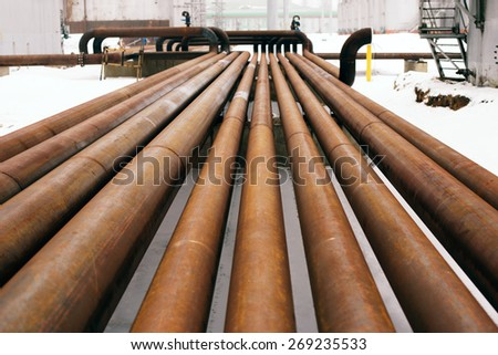 rusty steel pipes on a newly built industrial enterprises - stock photo