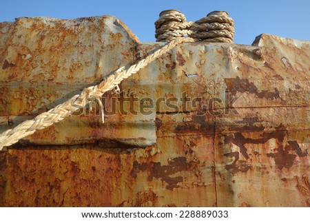 Rusty steel texture of an abandoned tanker boat closeup - stock photo