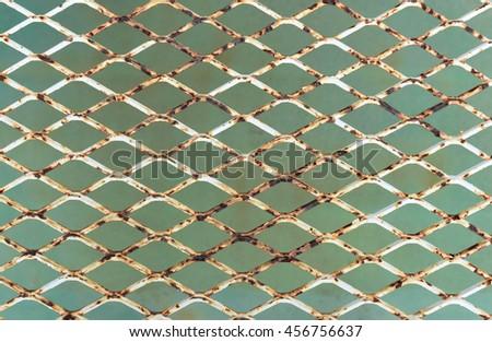 Rusty steel wire mesh - stock photo