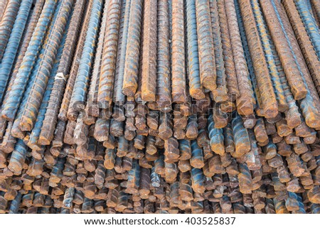 Rusty surface on steel rebars in the construction site. - stock photo
