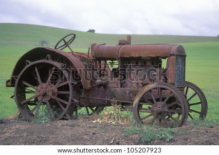 Rusty tractor near Paso Robles, CA - stock photo