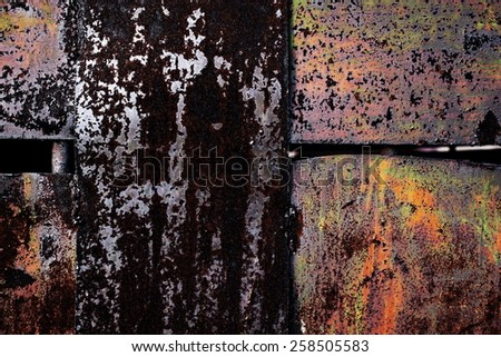 rusty worn and scratched metallic background with old cracked paint on it - stock photo
