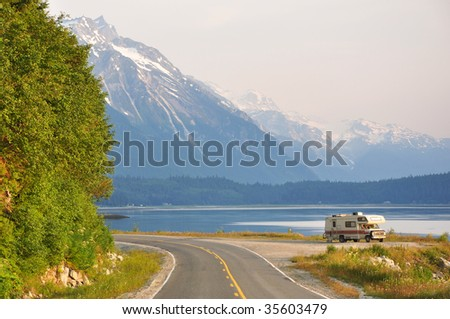 RV along Alaskan inlet - stock photo