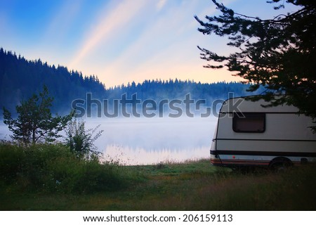 RV camper near lake, HDR sunrise in bulgarian nature  - stock photo