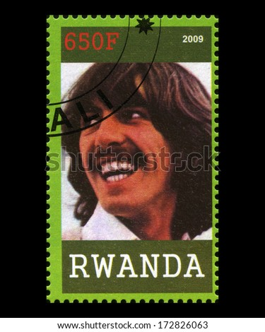 RWANDA, AFRICA - CIRCA 2009: A postage stamp from Rwanda portraying an image of George Harrison of The Beatles, circa 2009. - stock photo