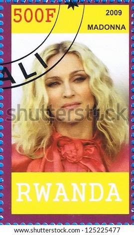 RWANDA - CIRCA 2009: A postage stamp printed in the Republic of Rwanda showing Madonna Louise Ciccone, circa 2009 - stock photo