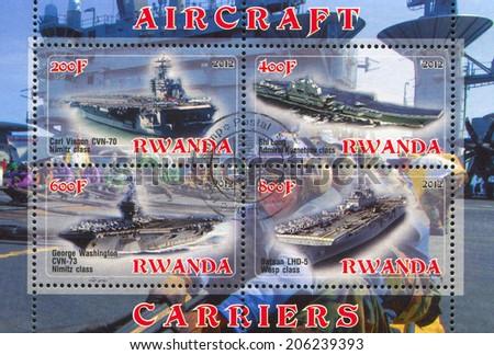 RWANDA - CIRCA 2012: stamp printed by Rwanda, shows aircraft carrier, circa 2012 - stock photo