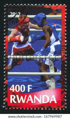 RWANDA - CIRCA 2012: stamp printed by Rwanda, shows boxing, circa 2012 - stock photo
