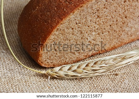 rye bread, and corn on the canvas - stock photo