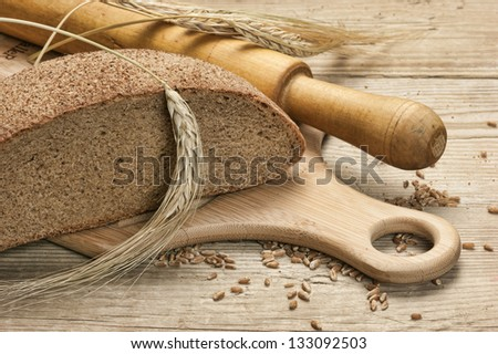 rye bread, and corn on the wooden table - stock photo