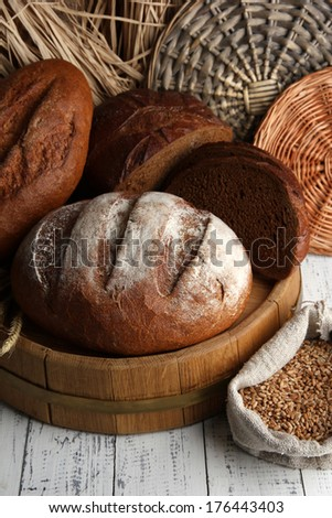 Rye bread on wooden stand on wicker background - stock photo