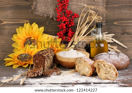 Rye bread on wooden table on wooden background - stock photo