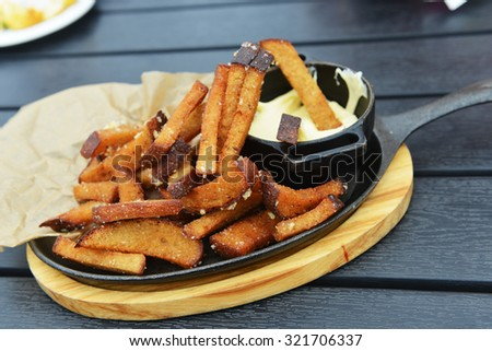 Rye bread roasted with salt and vegetable oil with cheese sauce, snack for beer - stock photo