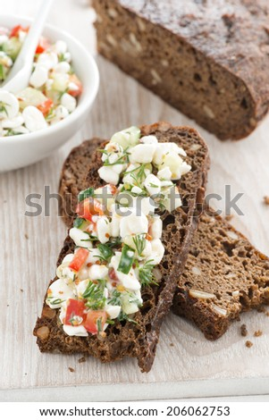rye bread with cheese and vegetables, top view, vertical - stock photo