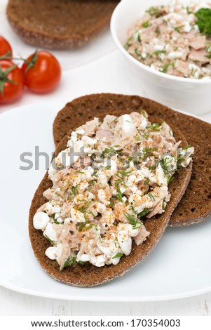 rye bread with tuna, homemade cheese and dill, vertical, top view - stock photo
