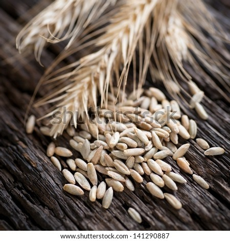 Rye on wooden ground - stock photo