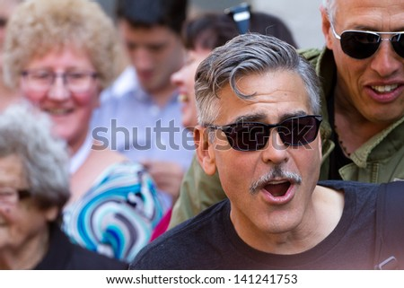 RYE, UK - JUNE 06: George Clooney spotted filming his new movie 'The Monuments Men' in RYE on the MAR 15, 2013 in London, UK - stock photo