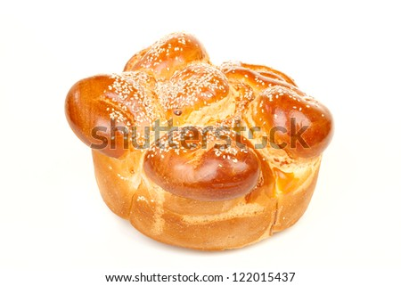 Sabbath challah with many white seed isolated on white background - stock photo