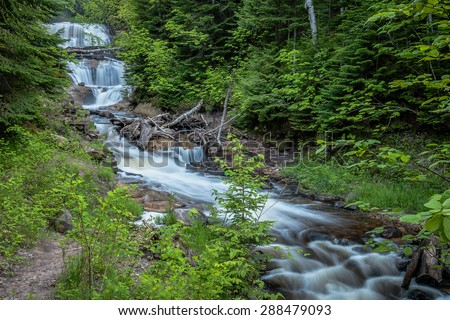 Sable Falls, one of the many waterfalls in the Pictured Rocks National Lakeshore. - stock photo