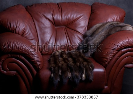 sable fur and leather chair - stock photo