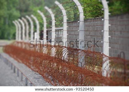 """Sachsenhausen-Oranienburg was a Nazi camp in Germany.A popular game amongst the guards involved threatening a prisoner with death if they did not stand on the """"death zone"""" gravel strip inside the camp - stock photo"""