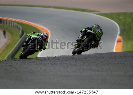 SACHSENRING - GERMANY, JULY 14: Italian rider Valentino Rossi leads Crutchlow at 2013 Eni MotoGP of Germany at Sachsenring circuit on July 14, 2013 - stock photo