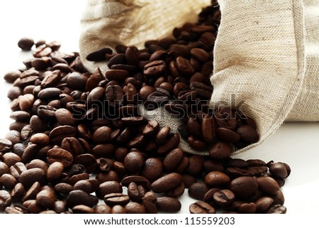 Sack full of coffee beans  over white background - stock photo