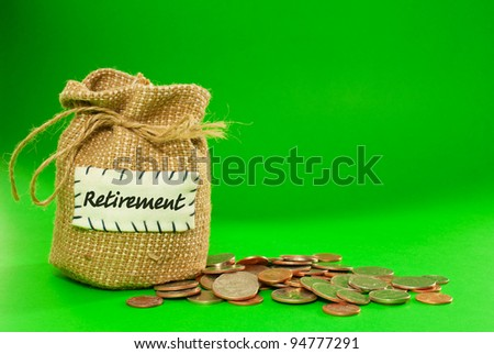 Sack full of coins over green background - stock photo