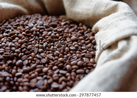 Sack of roasted coffee beans, close-up - stock photo