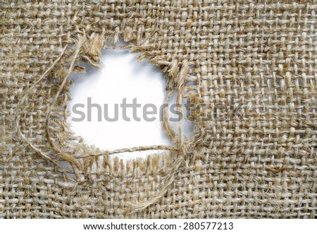 Sackcloth with a patched hole - stock photo