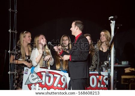 SACRAMENTO, CA - DECEMBER 2013: DJ Christopher K interviews fans at 107.9 The End's Jingle Ball at Sacramento's Memorial Auditorium in Sacramento, California on December 21, 2013 - stock photo