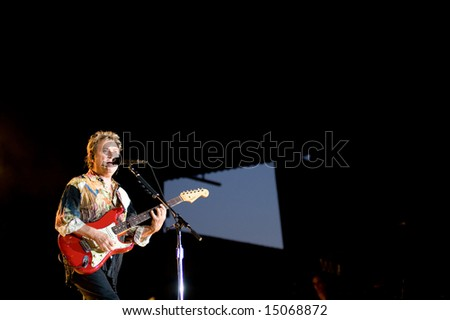 Sacramento, CA - July 17,2008: Bassist  Andy Summers performs on-stage at the Sleep Train Amphitheater in Marysville, CA with The Police in their North American Reunion Tour - stock photo